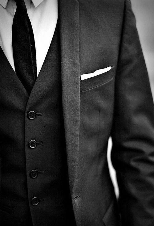 Como combinar chaleco negro con traje